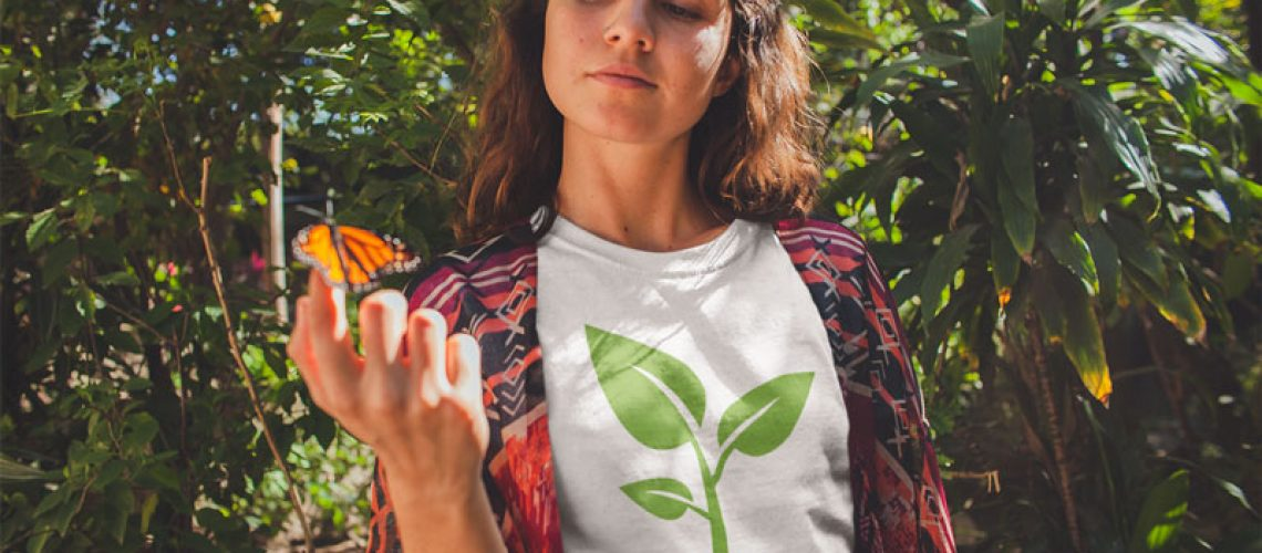 girl-holding-a-butterfly-wearing-a-tshirt-mockup-near-plants-a18458